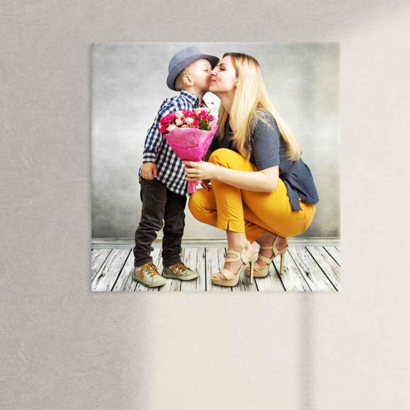 Adorable glass printed photo of mother getting flowers from her young son